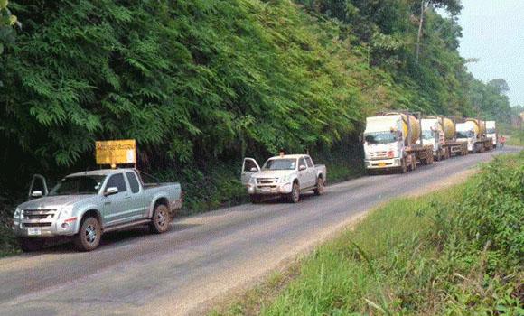 FPT Global truck convoy heading through thai laos mountains