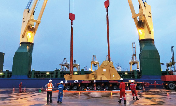 FPT Global loading giant excavator parts on to a vessel at laem chabang